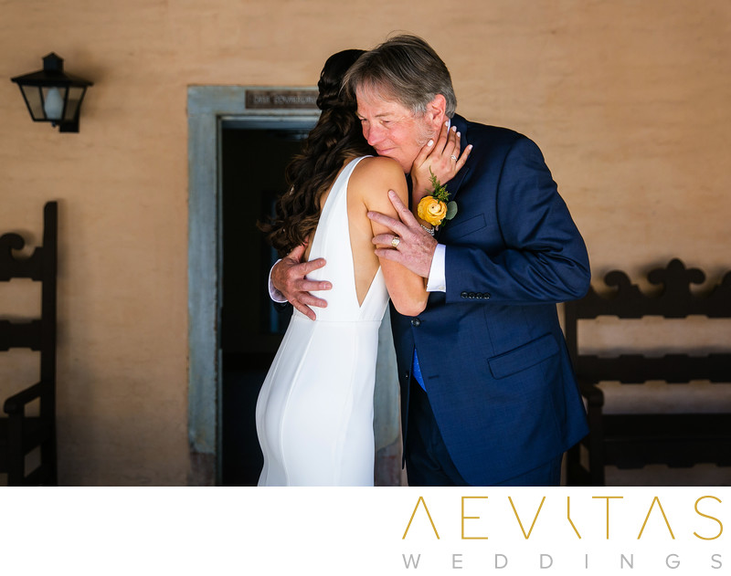 Bride and dad embrace during first look session