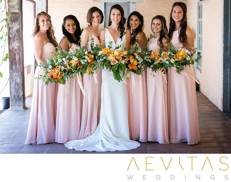 Bride and bridesmaids with bouquets portrait
