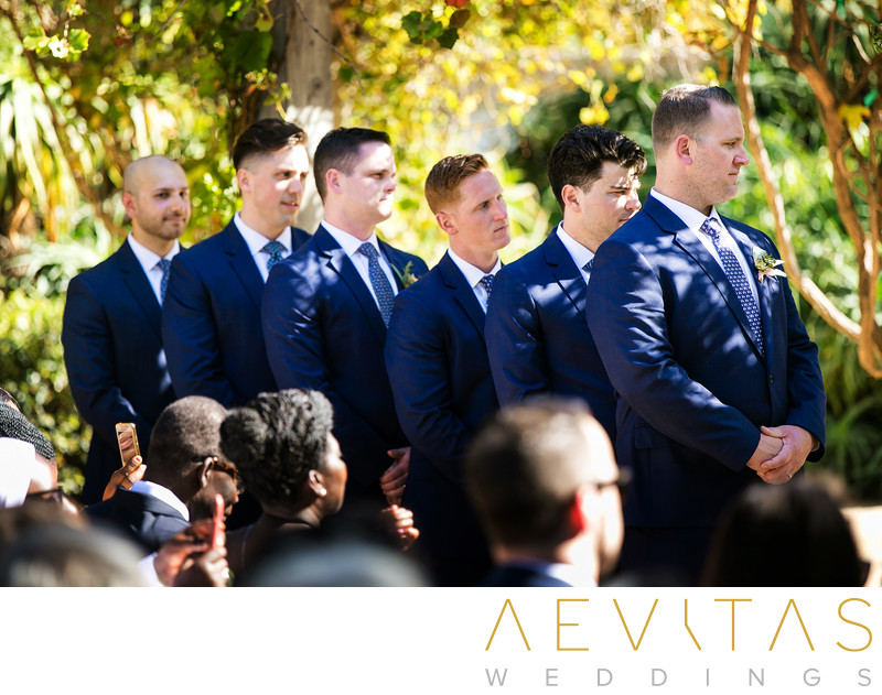 Groomsmen during garden wedding in Santa Barbara