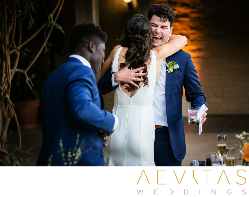 Bride embraces brother after wedding reception speech