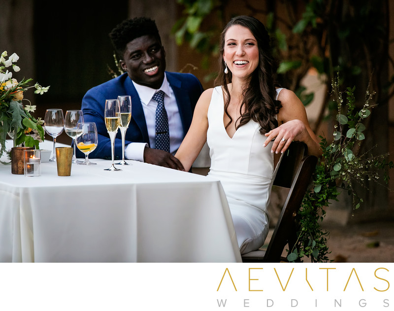 Beautiful couple photo at sweetheart table