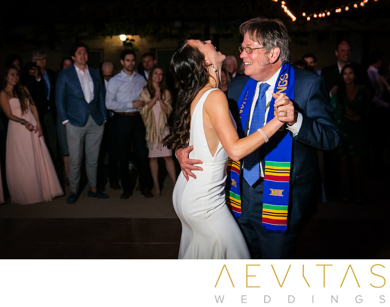 Candid photo of father-daughter reception dance