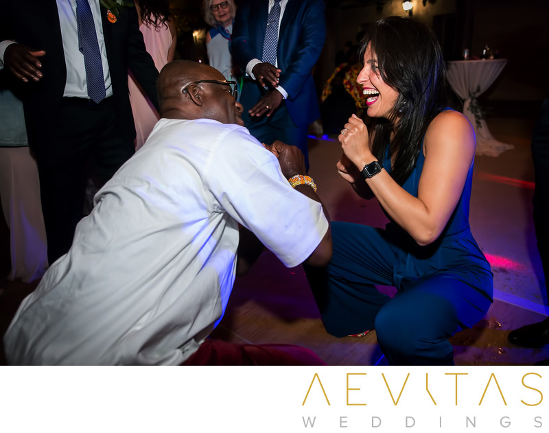 Two wedding guests getting down on dance floor