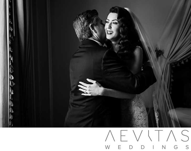 Black and white photo of father and bride embracing
