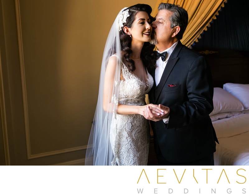 Father kisses bride during LA first look session