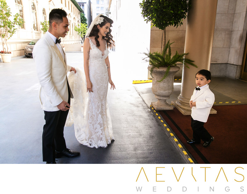 Couple with son photo at Los Angeles wedding