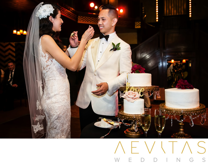 Bride and groom feed each other cake at Cicada wedding