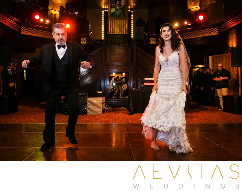 Fun photo of father-daughter wedding reception dance