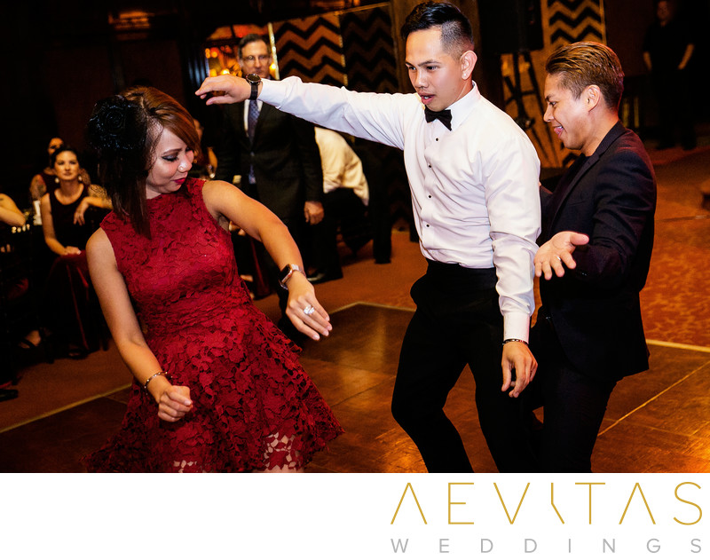 Groom and wedding guests dancing at LA reception