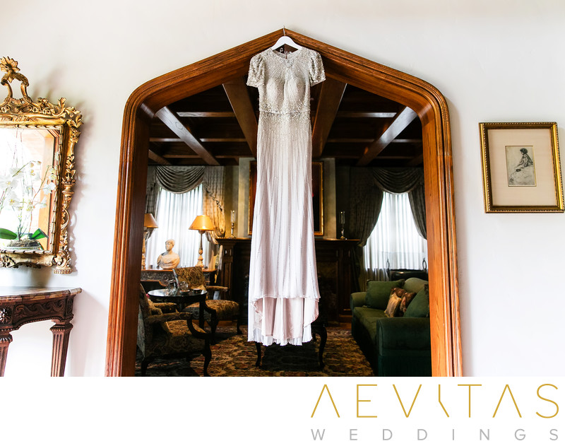 Wedding dress hanging in arched doorway in LA