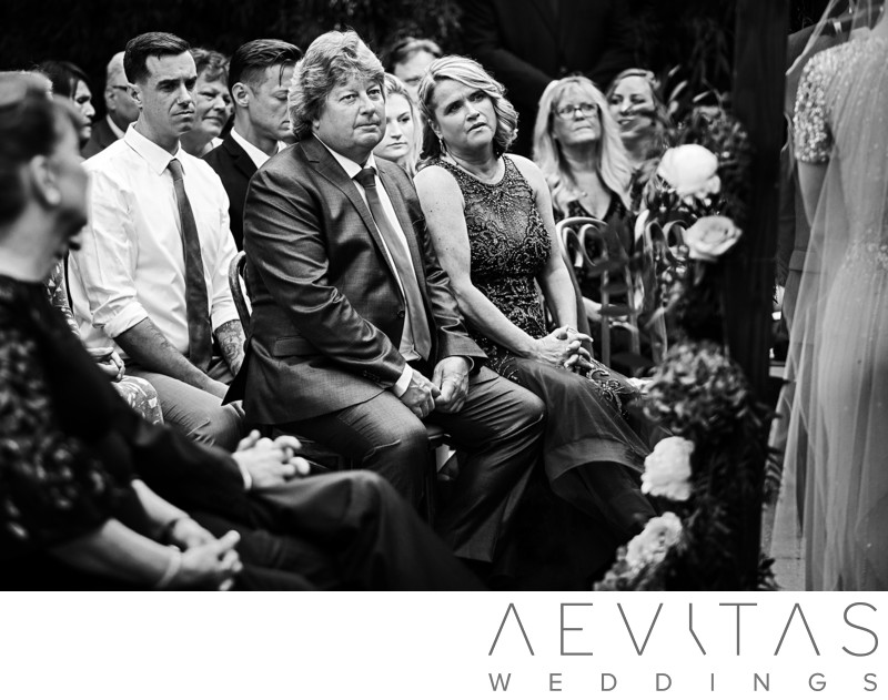 Black and white candid parent reactions at LA wedding