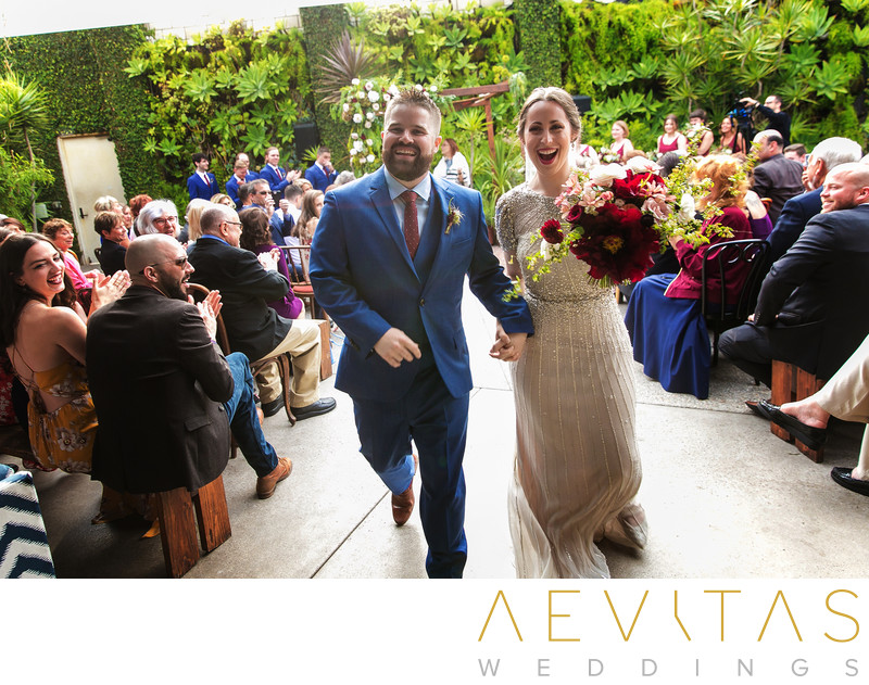 Couple smile during wedding ceremony recessional walk