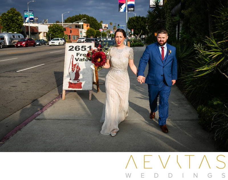 Couple walk along La Cienaga Boulevard in Los Angeles