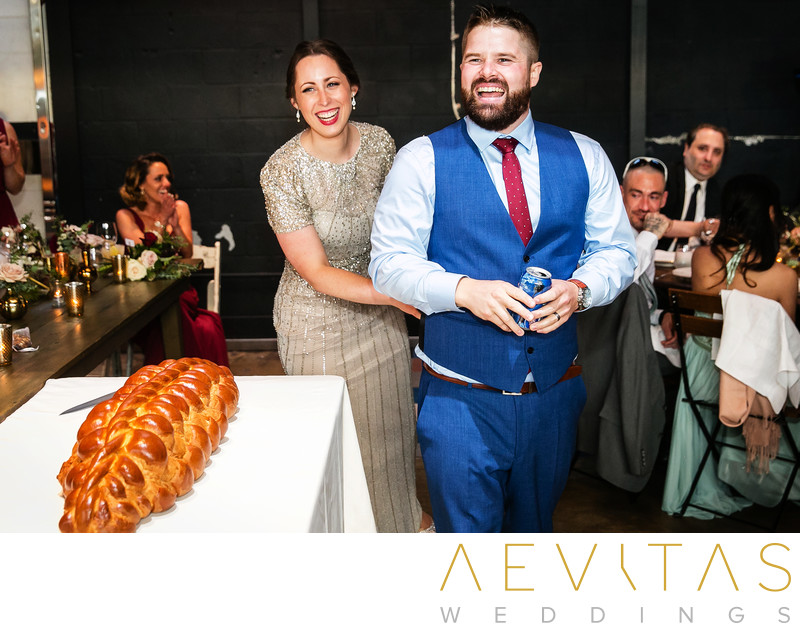 Bride and groom with bread at Jewish wedding reception