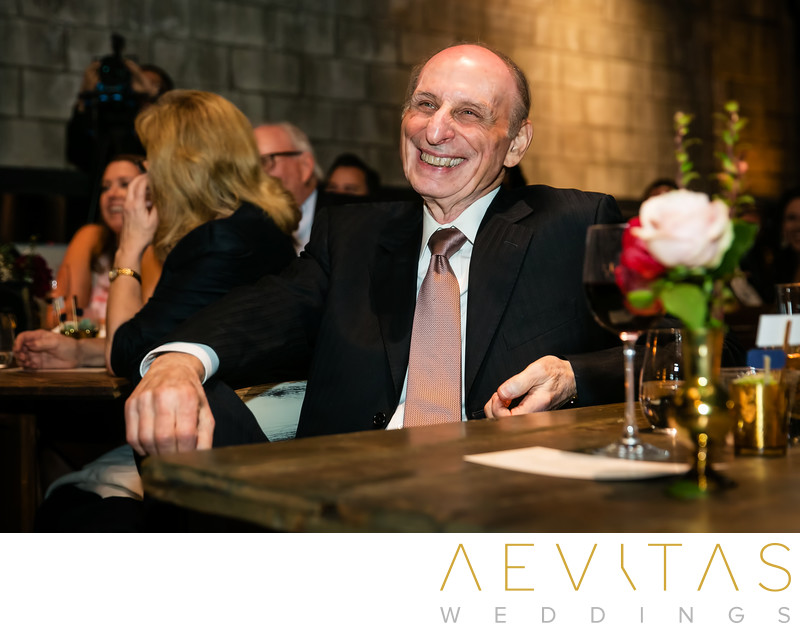 Father laughs during wedding reception speech