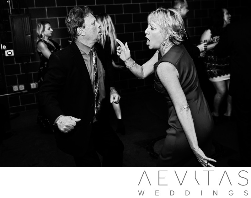 Black and white photo of wedding guests dancing in LA