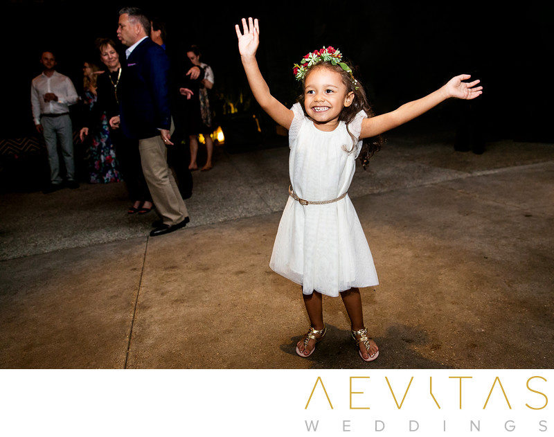 Cute flower girl dancing at SmogShoppe reception