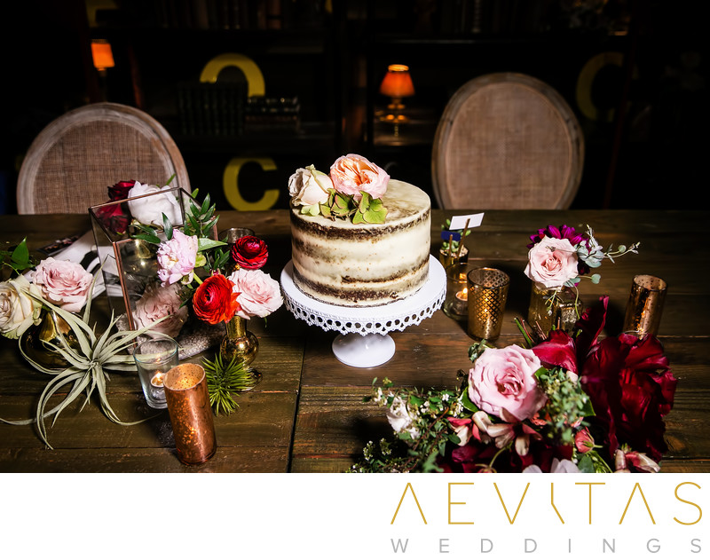 Wedding cake with flowers on wooden table in LA
