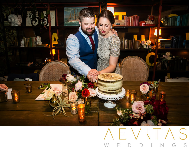 Couple perform cake cutting at SmogShoppe reception