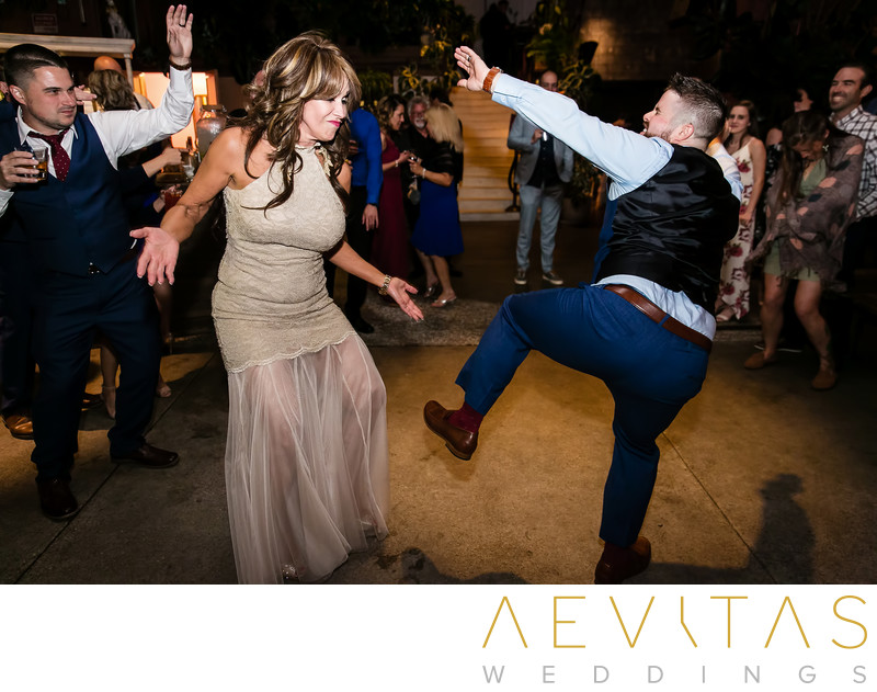 Funny photo of groom dancing at reception
