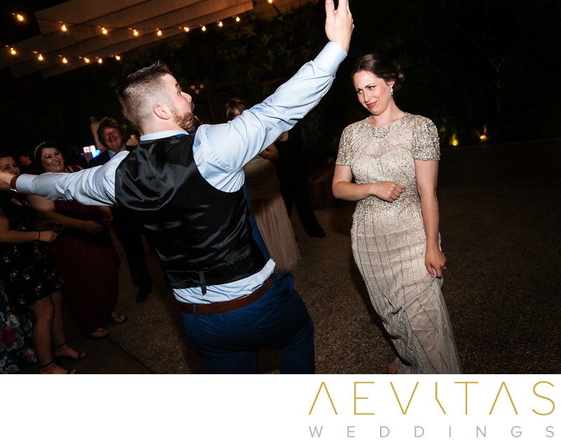 Groom dancing with funny bride expression in LA