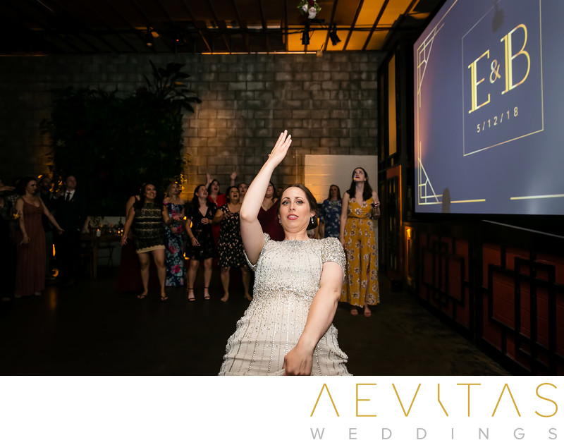 Action shot of bride's bouquet toss in Los Angeles