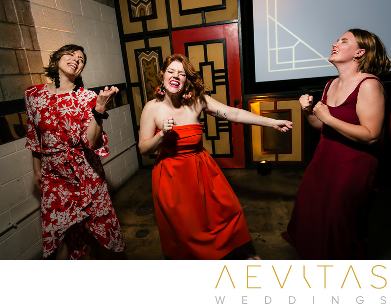 Fun action shot of female wedding guests dancing