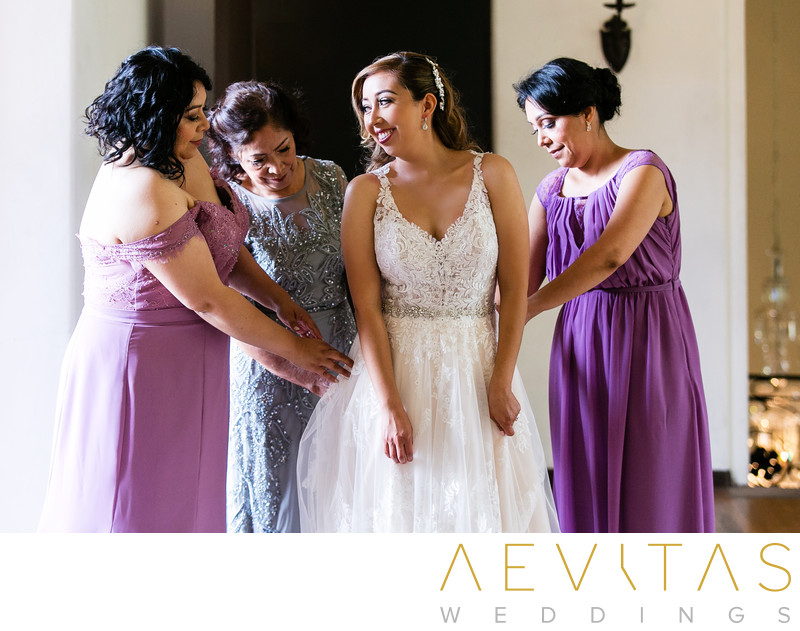 Bride getting ready with bridesmaids and mom