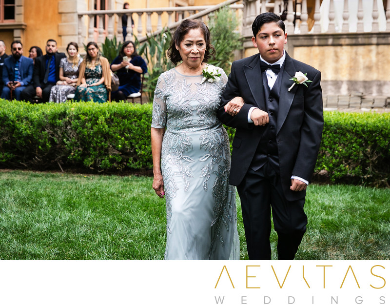 Mother-of-the-bride walking down Villa Del Sol aisle