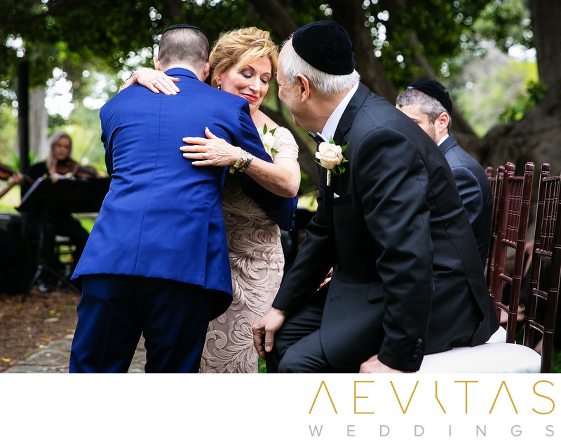 Groom hugs mom at Villa Del Sol D'Oro wedding