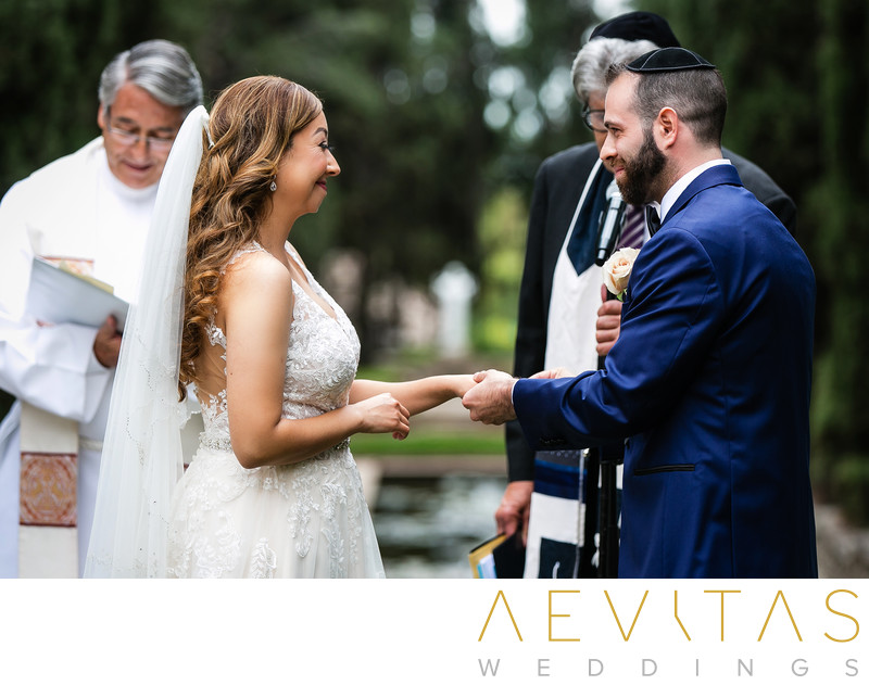 Bride and groom exchange rings at Villa Del Sol D'Oro
