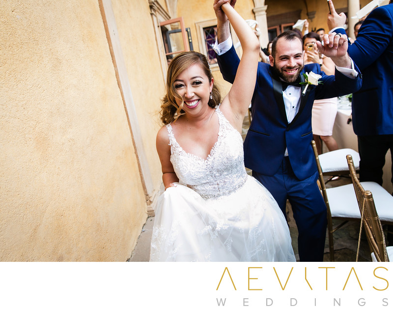 Bride and groom celebrate during grand entrance