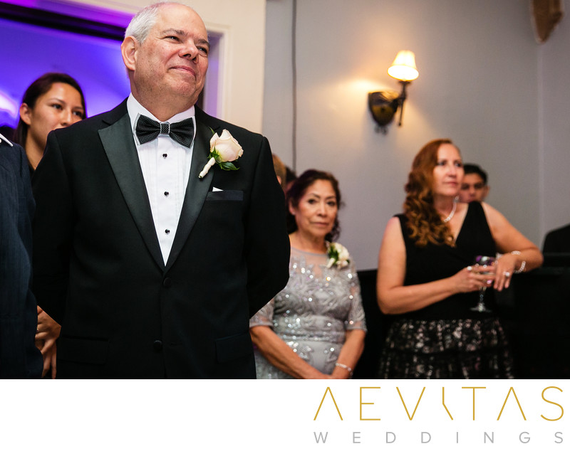 Father watching proudly during mother-son dance