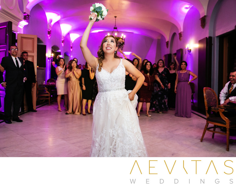 Bride bouquet toss at Villa Del Sol D'Oro wedding