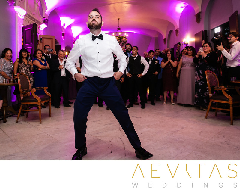 Groom dancing at Villa Del Sol D'Oro wedding reception