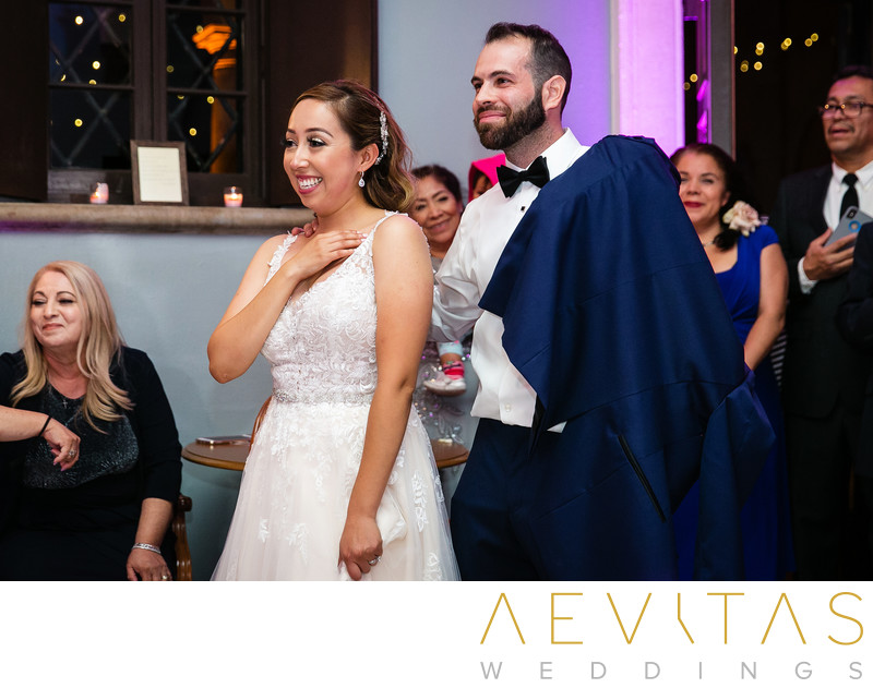 Bride and groom reaction during reception speech