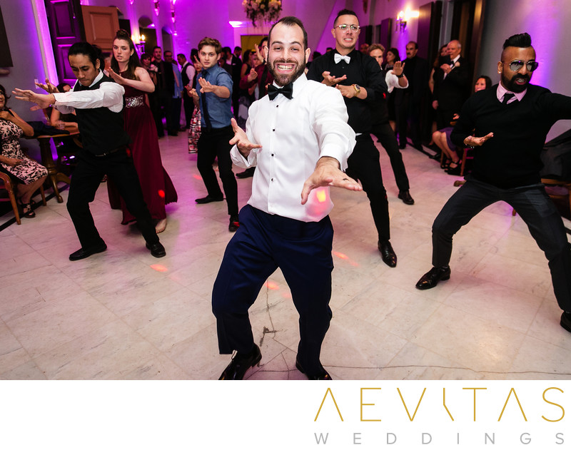 Groom dancing with friends by LA wedding photographer