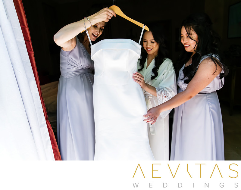 Bridesmaids admire wedding dress at The Houdini Estate