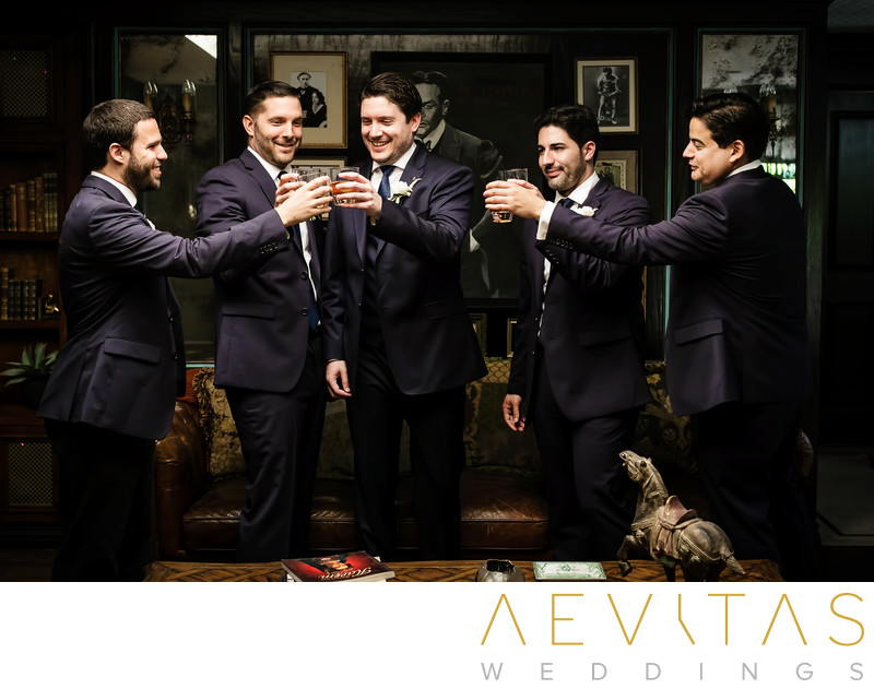 Groom and groomsmen toasting at The Houdini Estate