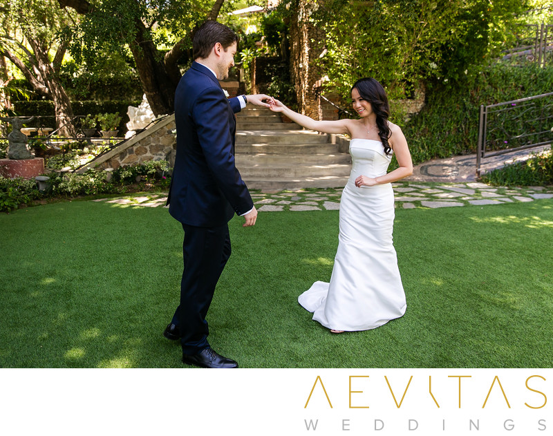Groom spins bride on lawns at The Houdini Estate