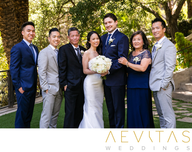 Couple with bride's family portrait in Los Angeles