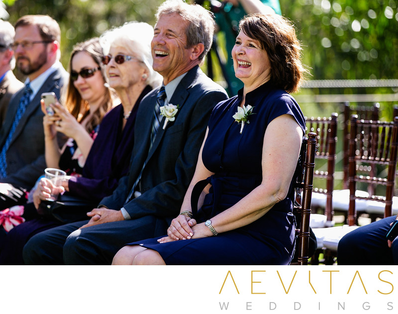 Groom parents laughing at The Houdini Estate wedding