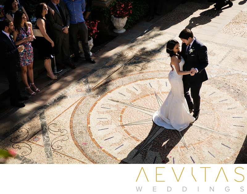 Elevated view of couple dancing on mosaic courtyard
