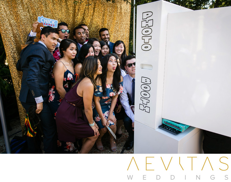Wedding guests in photo booth at The Houdini Estate