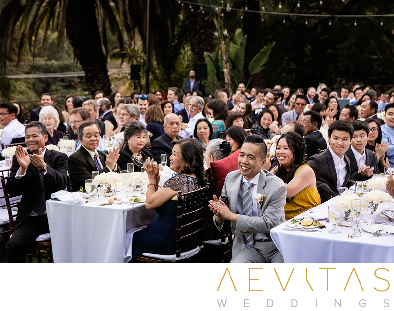 Wedding guests clapping during reception in Los Angeles