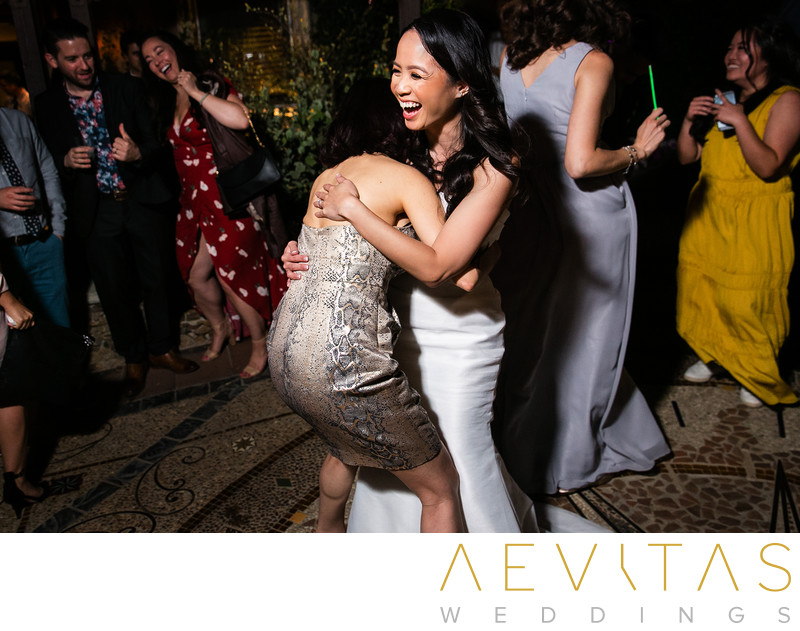 Fun moment with bride and wedding guest on dance floor
