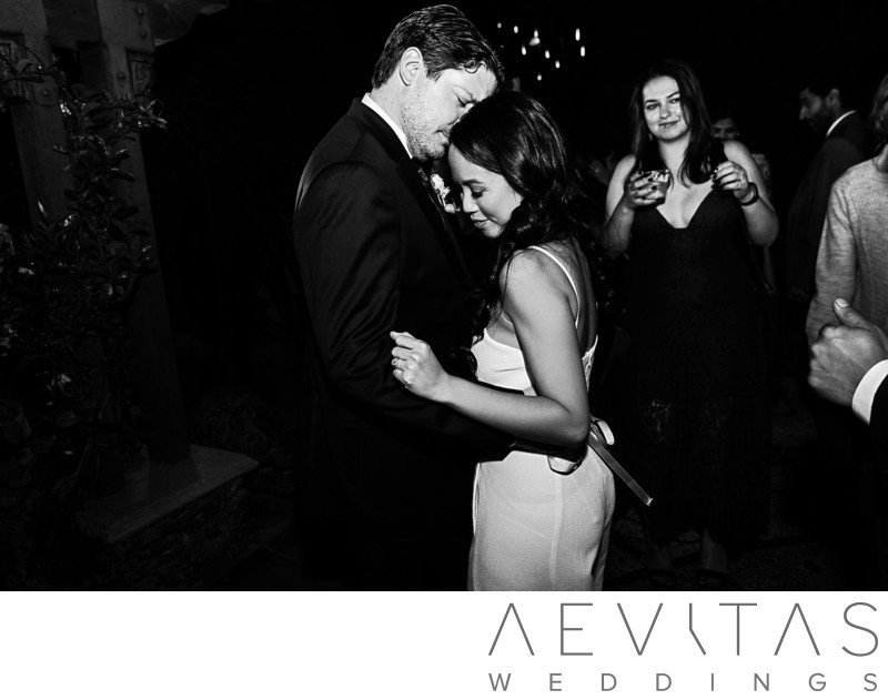 Black and white couple dance by LA wedding photographer