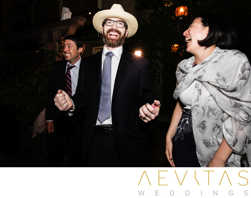 Wedding guest with hat on dance floor in Los Angeles