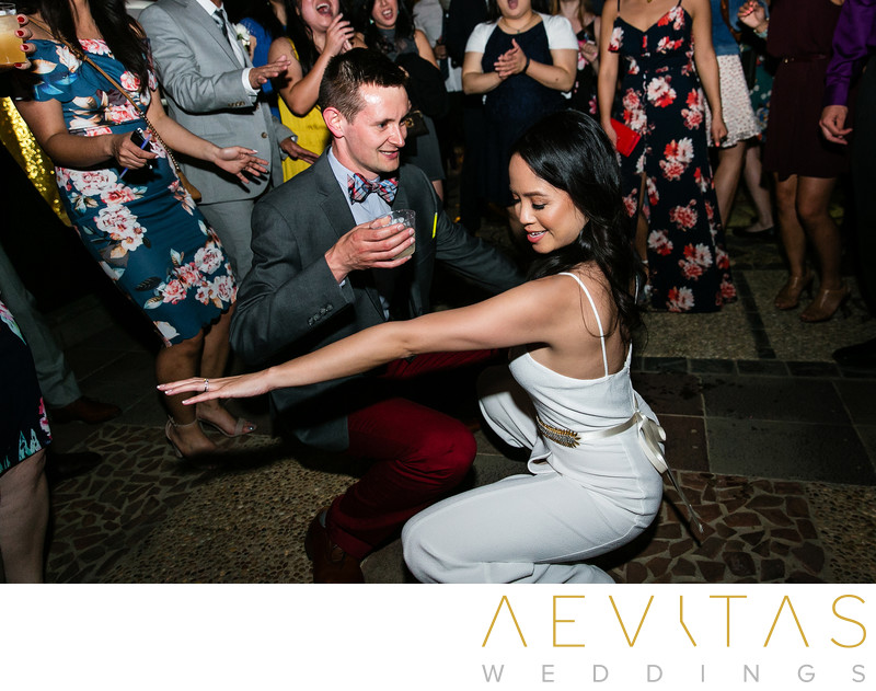 Bride and guest getting down on dance floor in LA