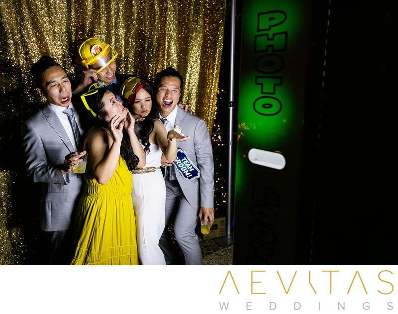 Bride and friends in photo booth at The Houdini Estate